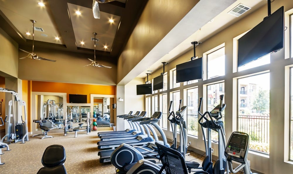Fitness Center with Cardio Machines at Discovery at Rowlett Creek apartments