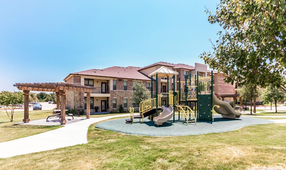 Playground at Discovery at Rowlett Creek apartments