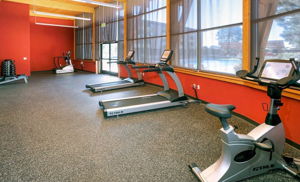 Fitness center at Advenir at The Village apartments