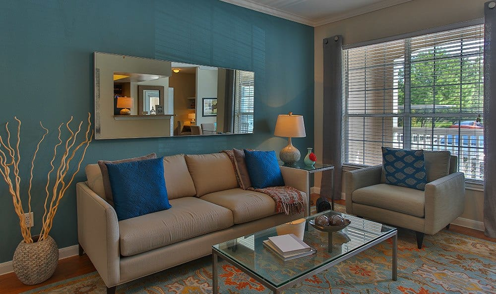 Your new living room at Advenir At Stone Park in Houston is spacious and comfortably designed