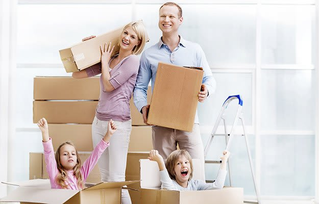 Picture Of A Happy Family Getting Ready To Move Their Belongings Into A Magellan  Storage Facility ...