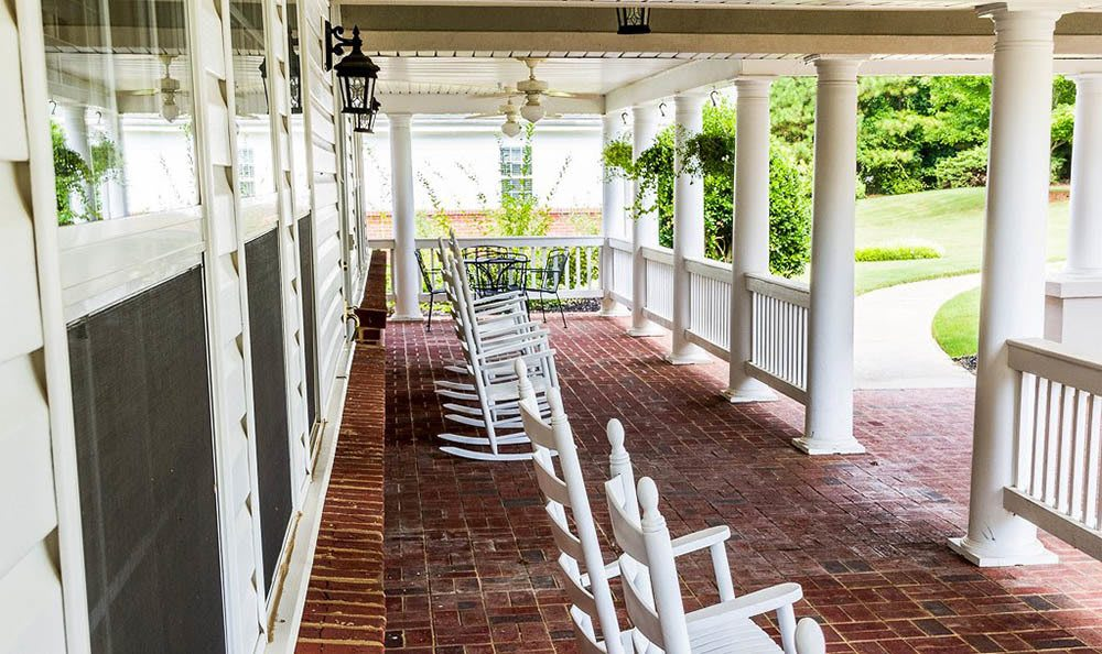 Front porch with rocking chairs at The Phoenix at Roswell