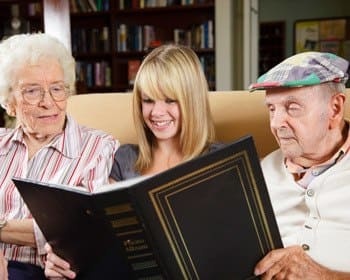 Viewing a photo gallery of memories at Phoenix Senior Living