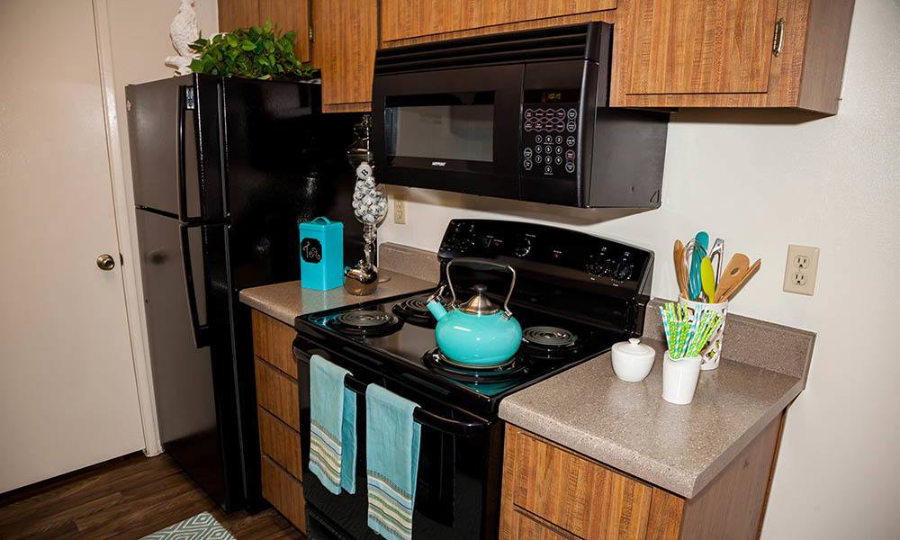 Kitchen With Black Appliances at Willow Creek Apartments in Tempe, AZ