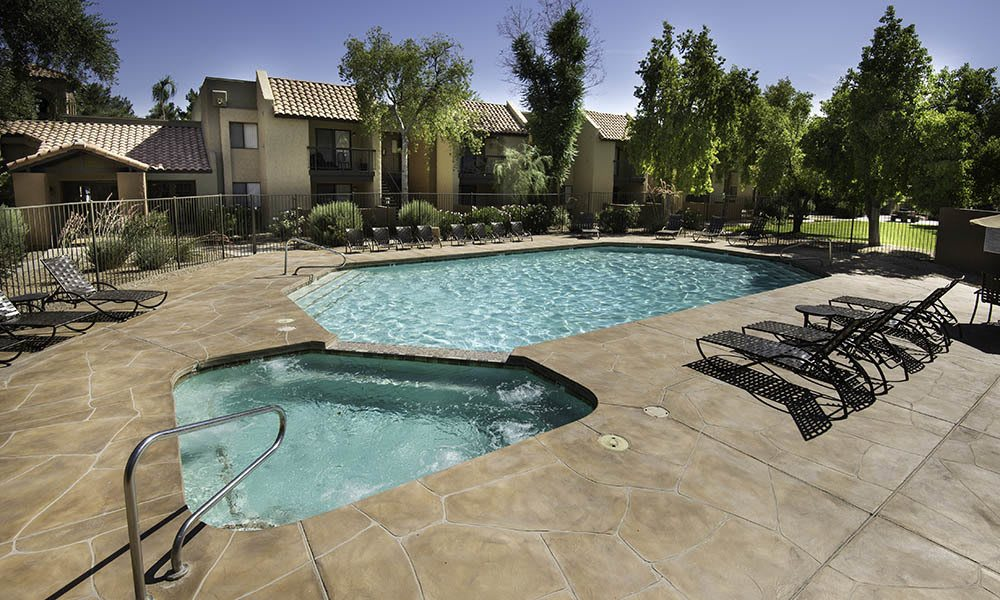 Swimming Pool And Hot Tub at River Ranch Apartments in Chandler, AZ