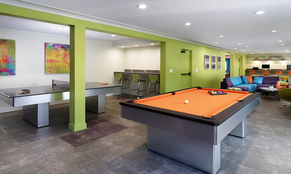 Pool And Ping Pong Tables at UCA Apartment Homes in Fullerton, CA