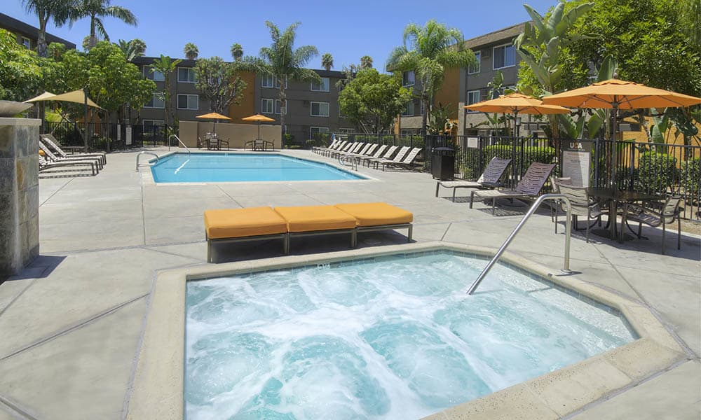 Resort Style Hot Tub And Pool at UCA Apartment Homes in Fullerton, CA