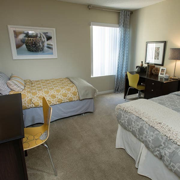 Shared Student Bedroom With Desks at UCA Apartment Homes