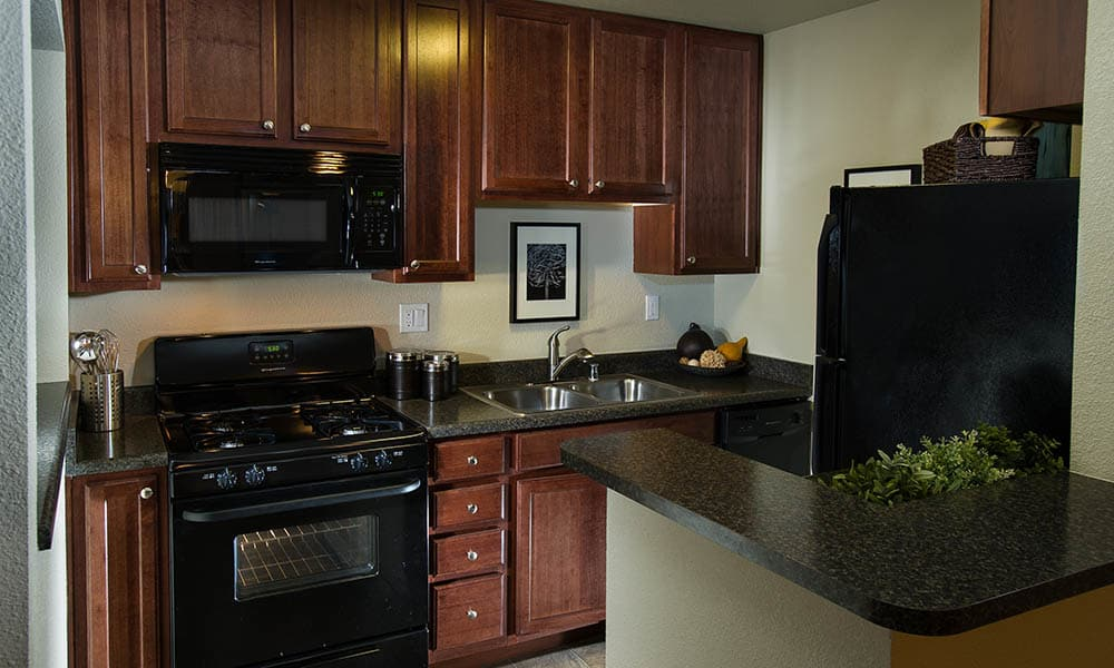 Well-Appointed Kitchen at UCA Apartment Homes in Fullerton, CA