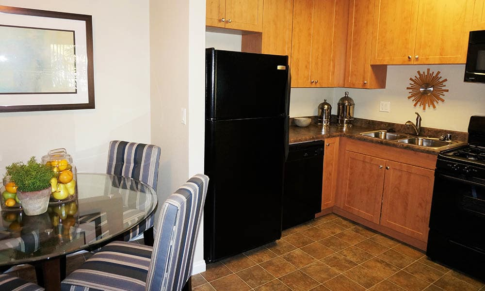 Dining And Kitchen Area at UCE Apartment Homes in Fullerton, CA