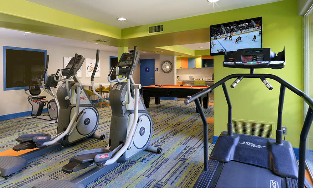 Fitness Center at UCE Apartment Homes in Fullerton, CA