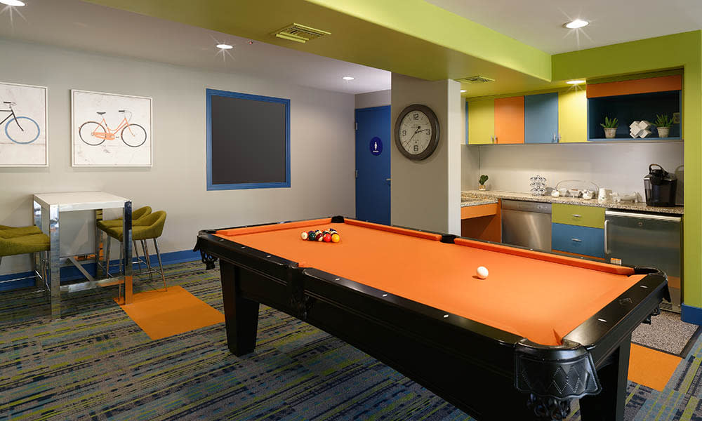 Pool Table And Clubhouse Kitchen at UCE Apartment Homes in Fullerton, CA