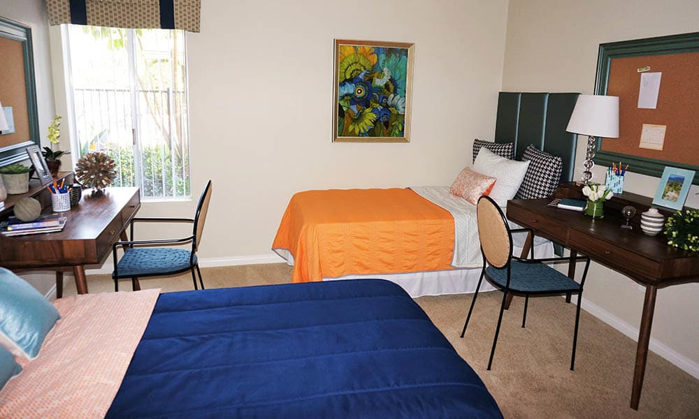 Shared Bedroom at UCE Apartment Homes in Fullerton, CA