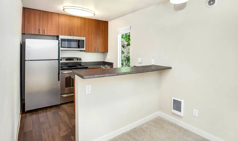 Kitchen with hardwood floors at The VUE