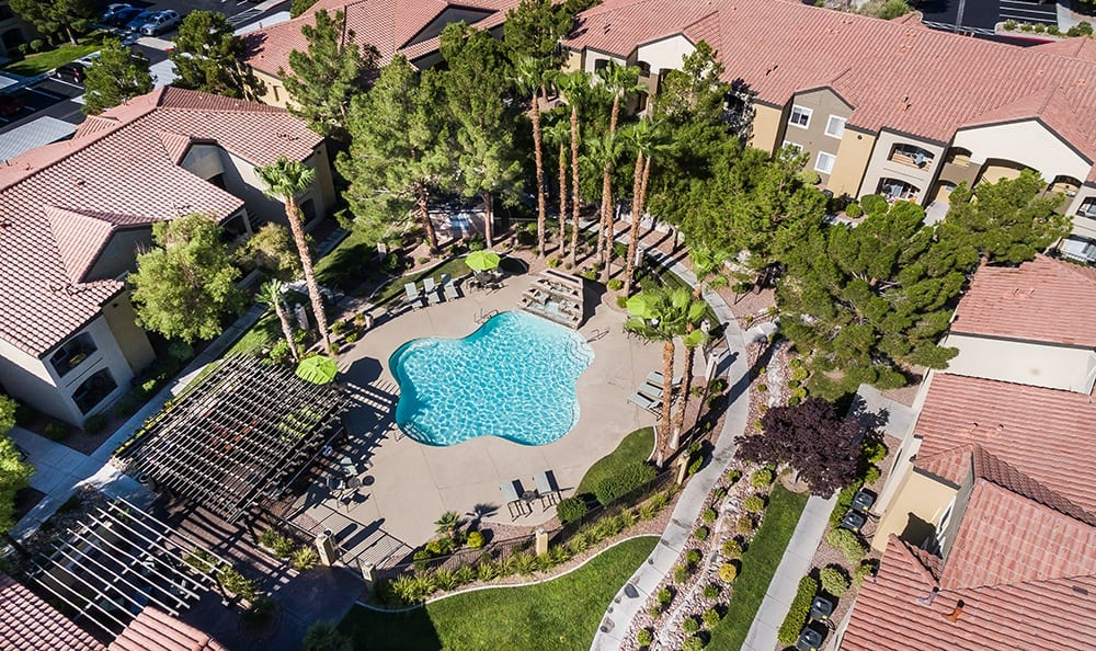 An aerial view of the resort-style pool at Rancho Destino Apartments.