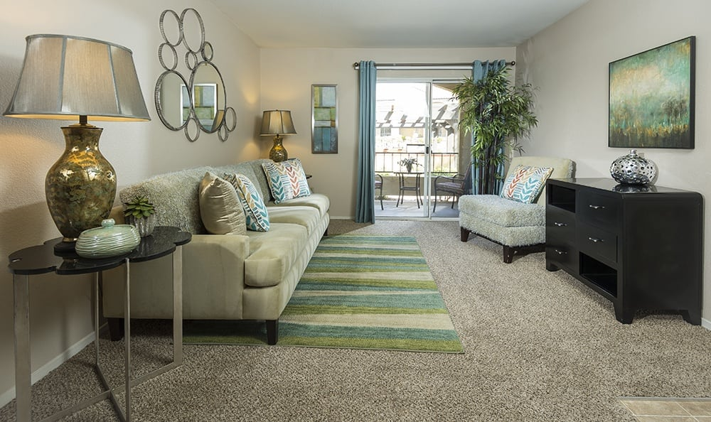A spacious living room at the apartments for rent at Rancho Destino Apartments.