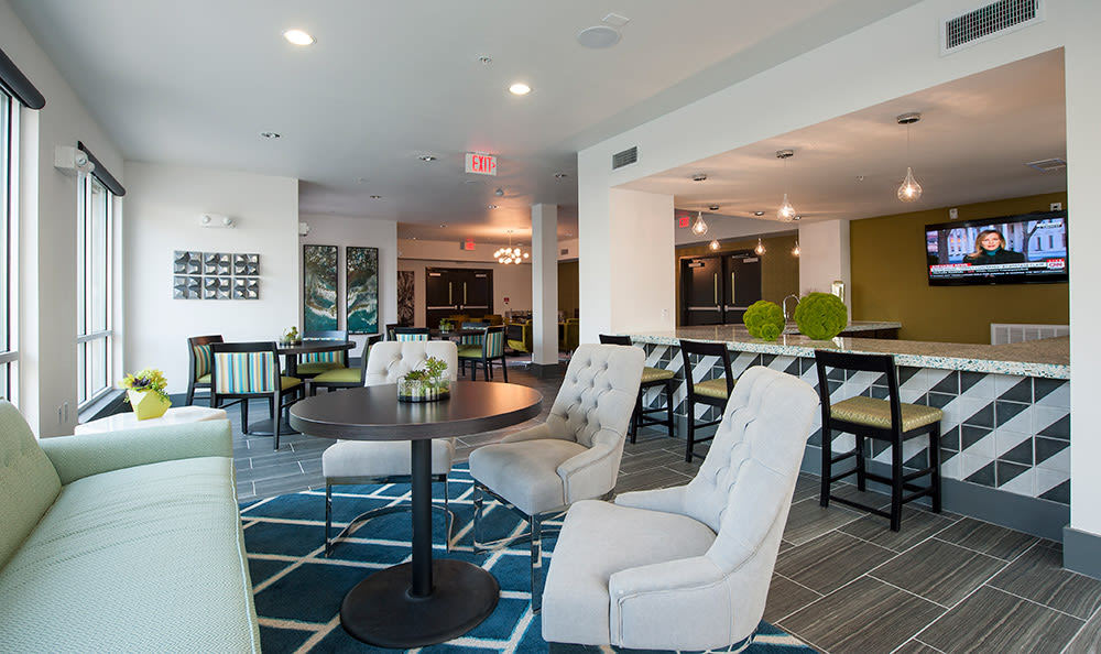 Relax in the resident lounge with your new friends at Sunrise By The Park