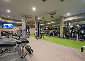 Work out in the on-site fitness center at Sunrise By The Park