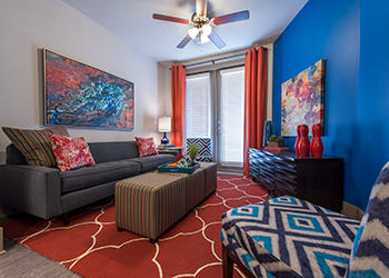 Model living room at Sunrise By The Park luxury apartments