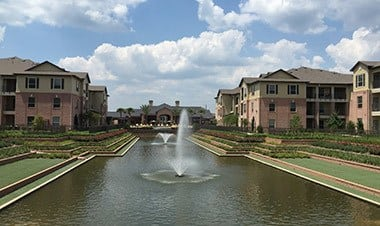 View Of The Lake With Fountains at Sunrise Briar Forest in Houston, TX
