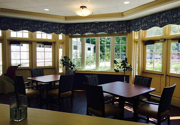 Dining room at Memory Care Community at The Ambassador of Scarsdale