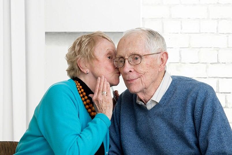 Seniors whisper to each other at the senior living community in Irvine