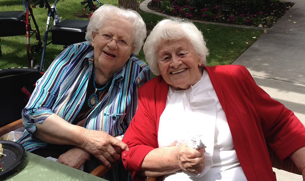 The Wellington senior living community shows happy friends in Salt Lake City
