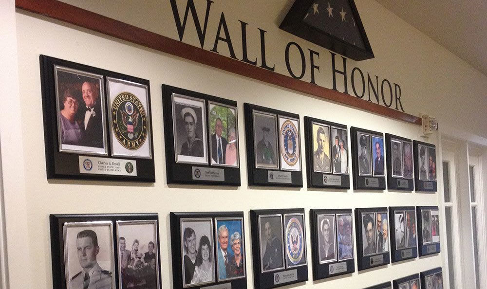 Wall of Veteran's photos at The Wellington senior living community in Salt Lake City