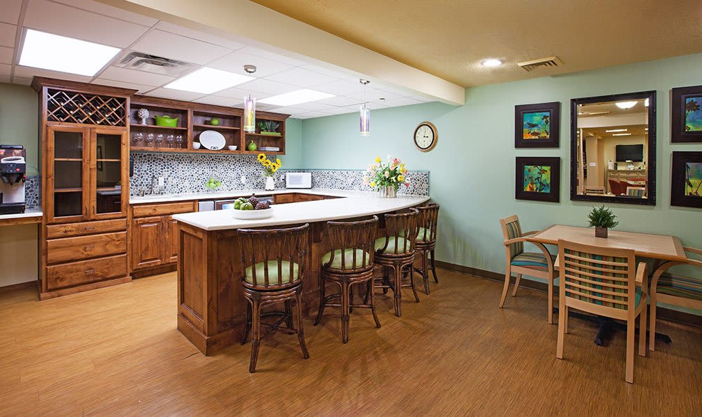 Kitchen and dining area at Chancellor Gardens at Clearfield senior living community in Clearfield, UT