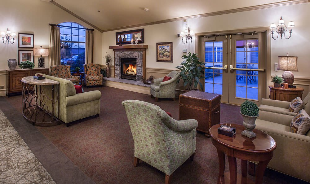 Senior living in Clearfield has a cozy sitting area with a fireplace for relaxing