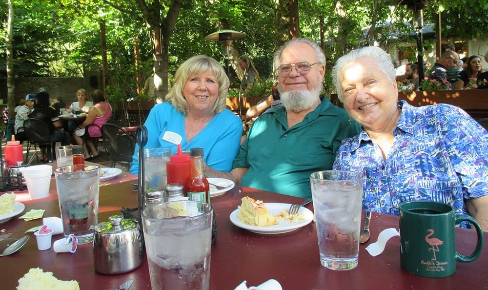 Friends dining outdoors at the senior living community in Salt Lake City