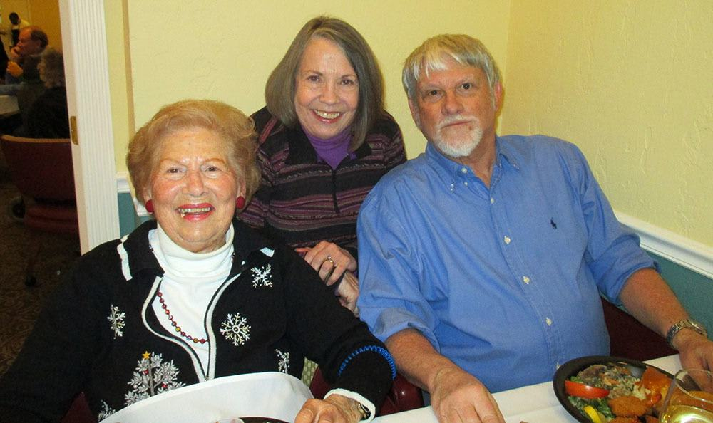 All smiles at the Christmas dinner at the senior living in Salt Lake City