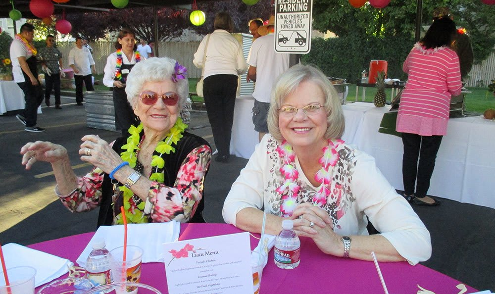 Residents enjoying a Luau Party at the senior living community in Salt Lake City