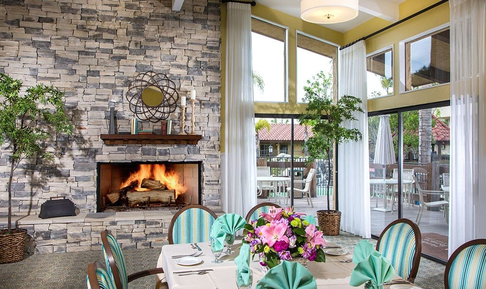 Dining area with fireplace at the senior living community in Huntington Beach