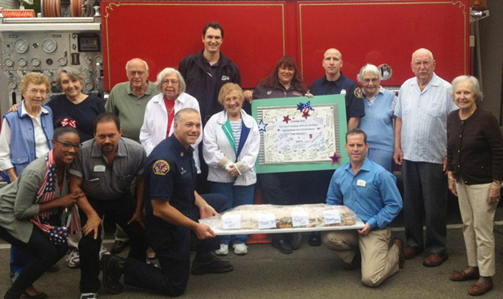 Presenting a huge sandwich to firemen at Oakmont Gardens