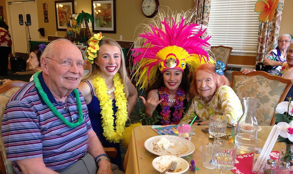 Fun costumes at the Hawaiian event at the senior living community in Cedar Hills