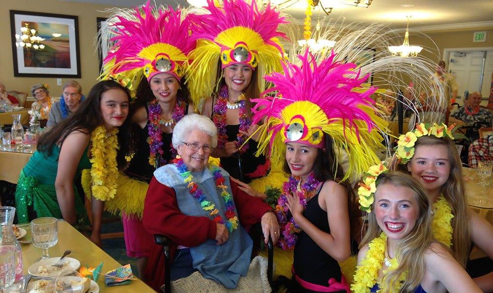 Fun Hawaiian costumes in Cedar Hills senior living community