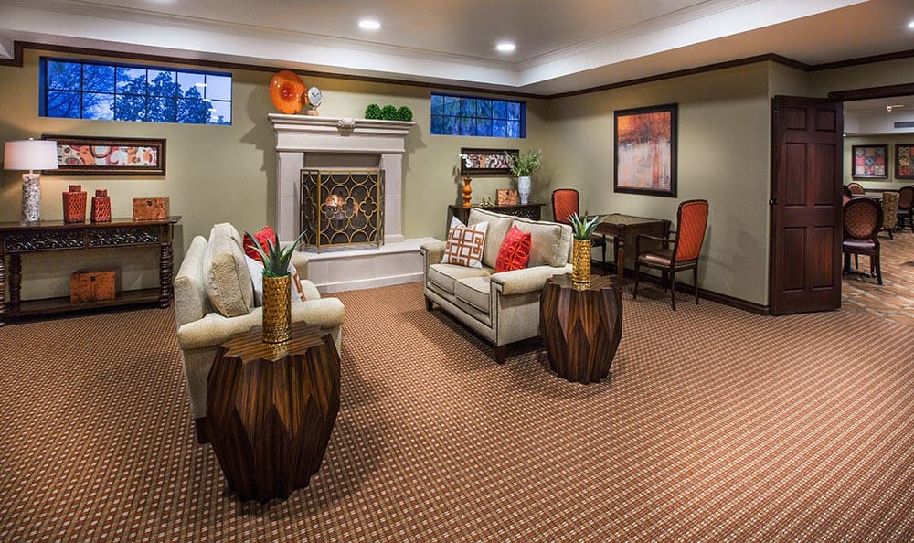 Tucson senior living community with cozy fireplace in the clubhouse