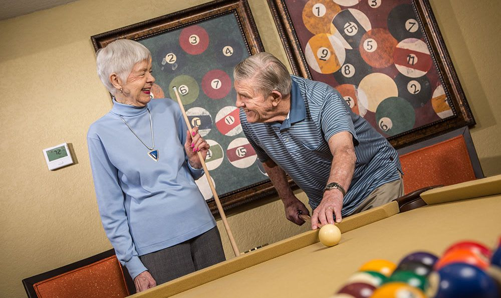 Enjoying the billiard table at the senior living community in Tucson