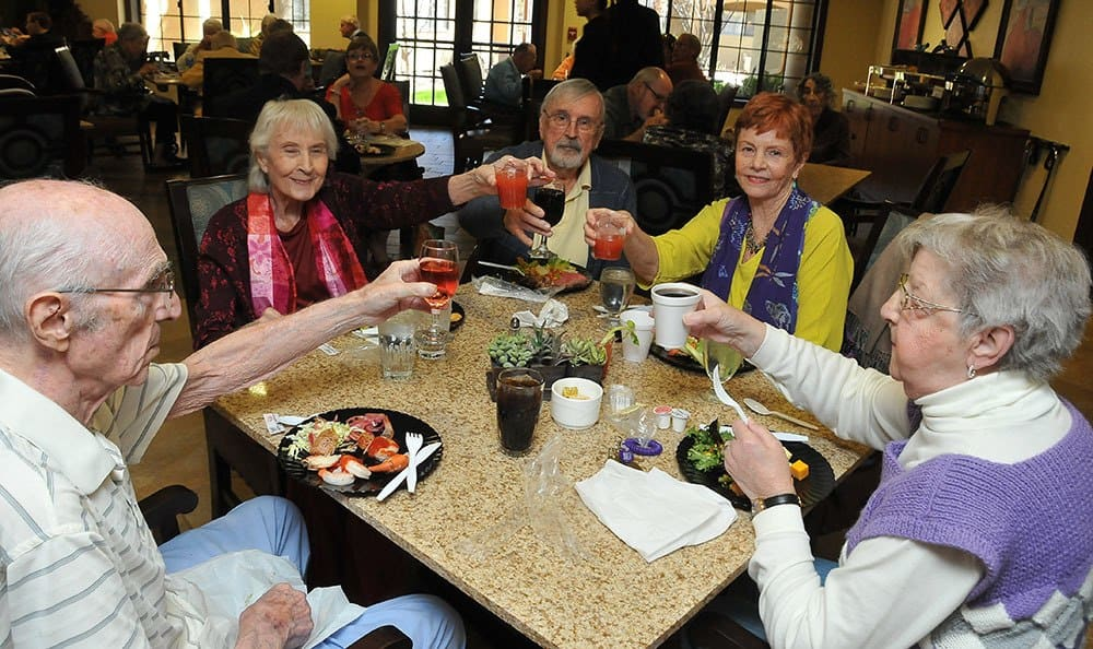 Residents enjoying food and spirits at the senior living community in Tucson