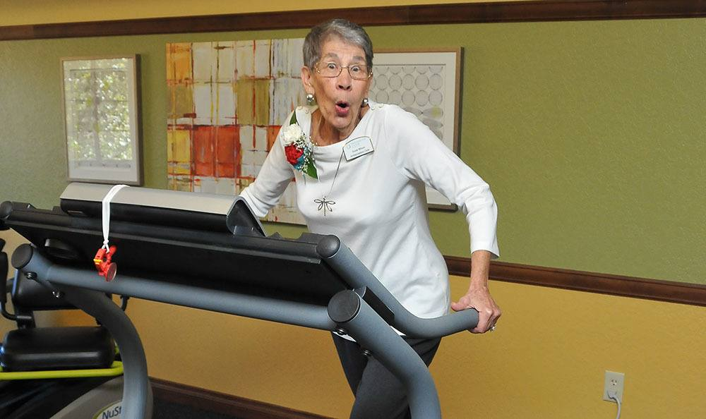 Woman enjoying the fitness room at the senior living community in Tucson