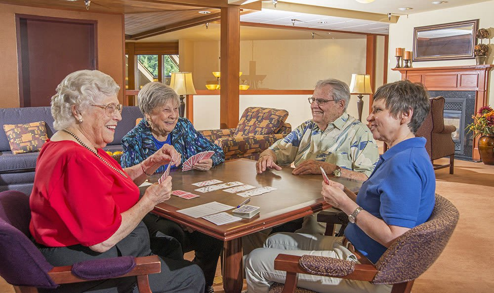 Playing cards with friends at the senior living community in Olympia