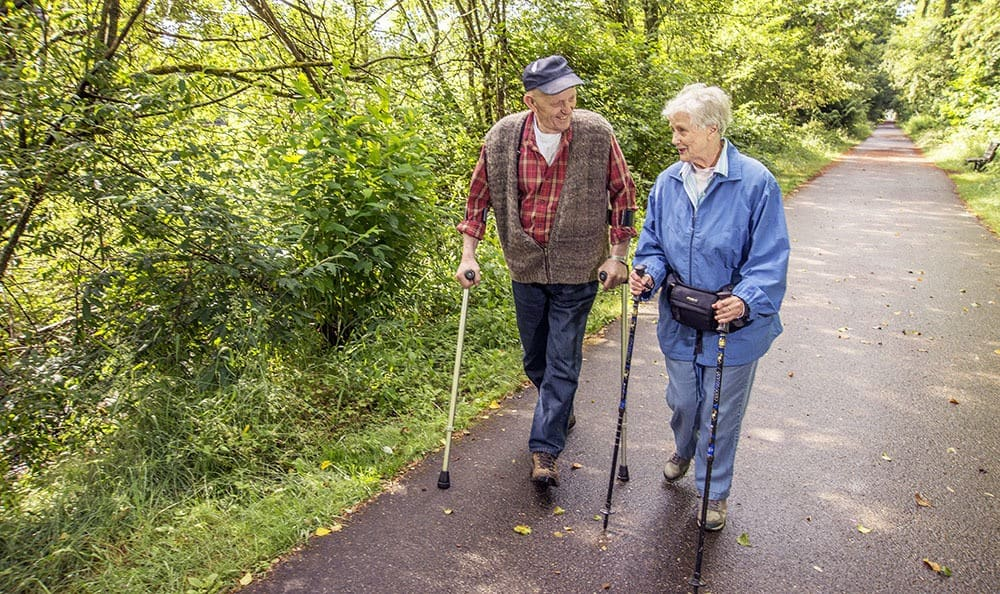 Couple enjoying the hiking trails in WA senior living community