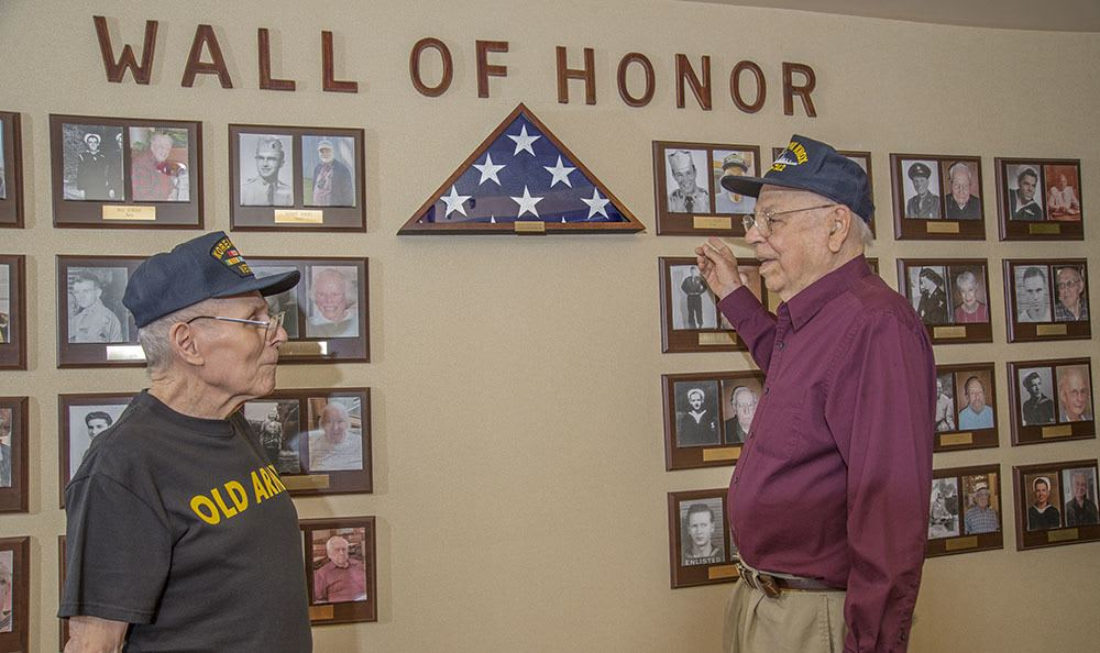 Veteran residents telling their stories at the Wall of Honor at The Firs