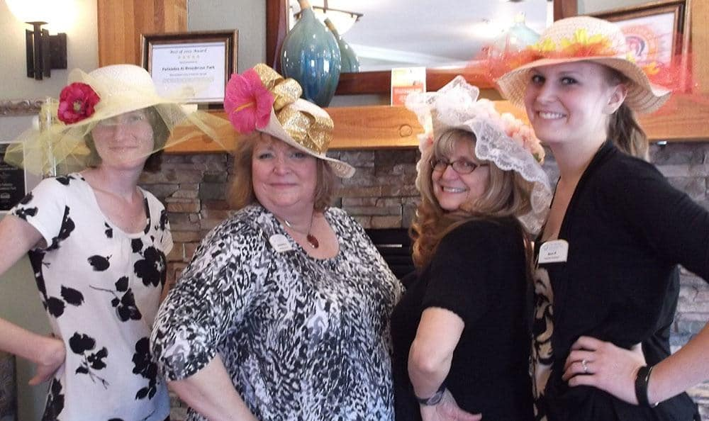 Employees pose in their Derby hats at the senior living community in Colorado Springs