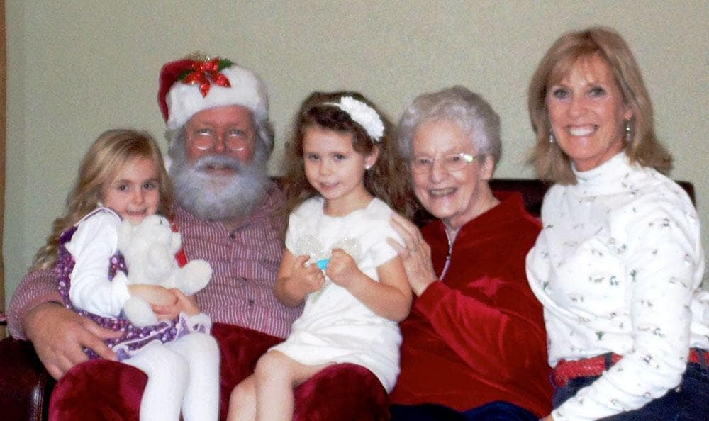 A family poses with Santa Claus in Colorado Springs senior living