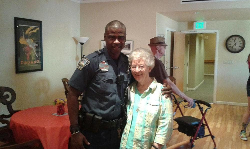 Resident enjoying a visit from the police at the senior living community in Colorado Springs