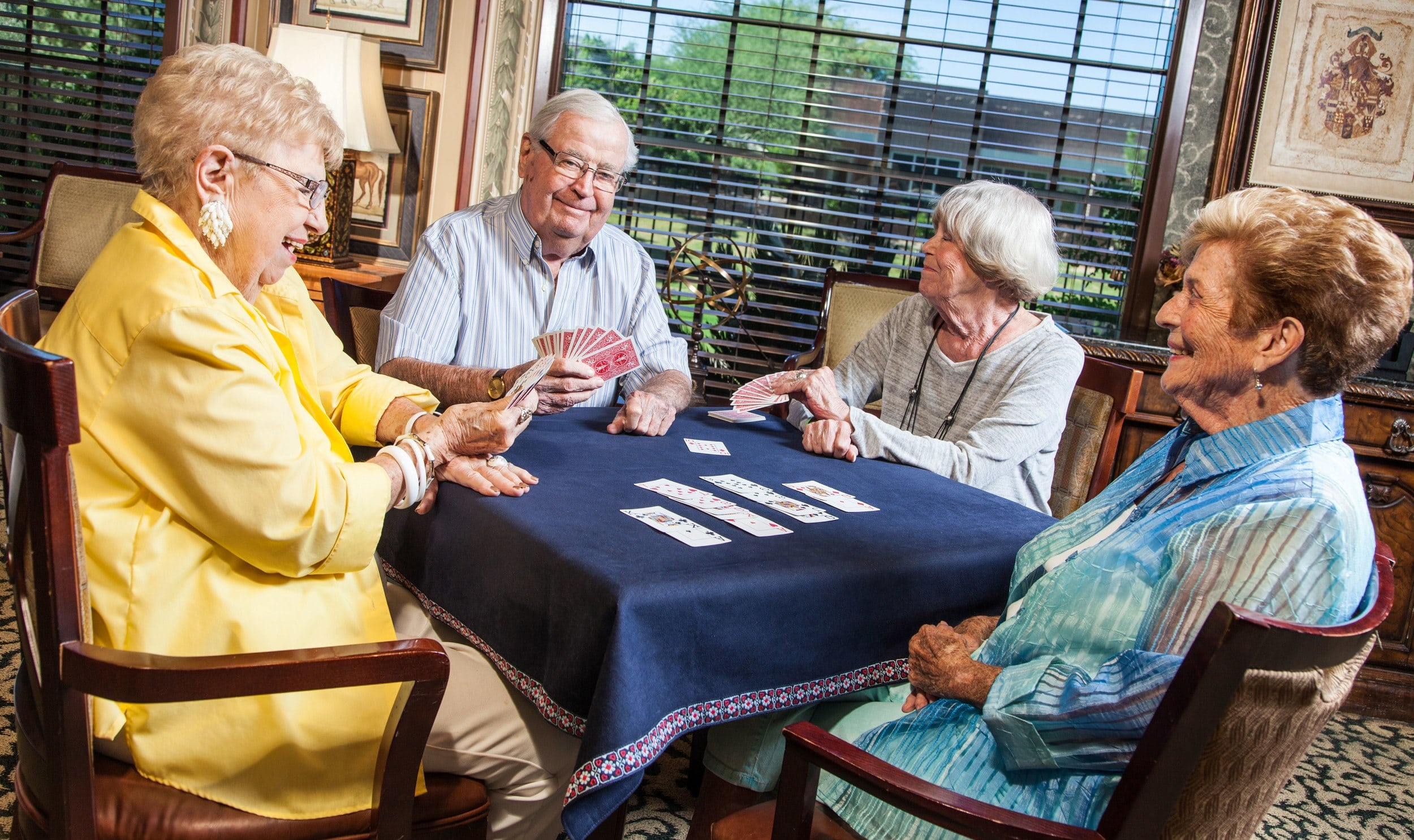 Residents playing cards together at Tuscany at McCormick Ranch senior living community in Scottsdale