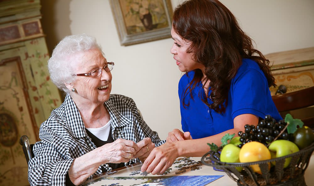 Highland Senior Living Community shows a Resident with an Aid