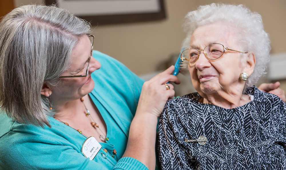 Senior Living in Highland shows a Resident Brushing her Hair